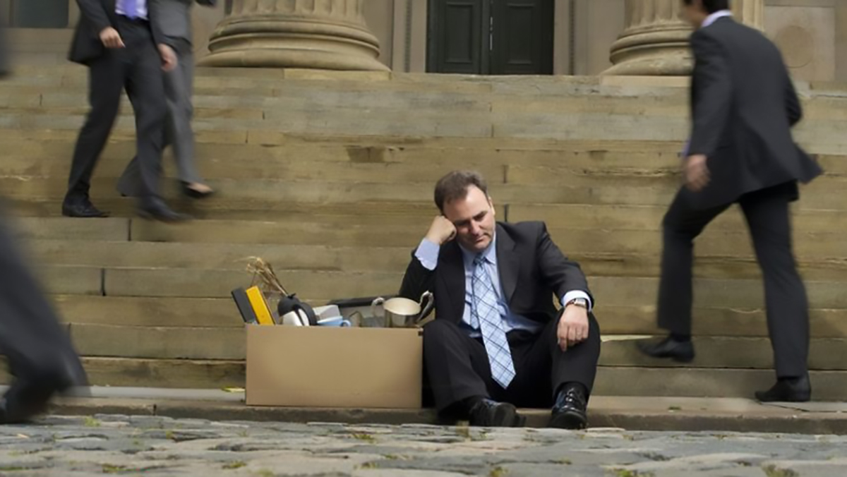 Banker sitting on the street